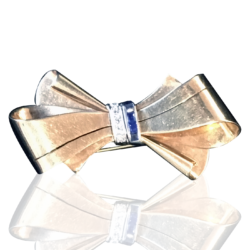 [unattributed] 14 kt gold jewelry : Retro bow pin with sapphires & diamonds, ca.1940.
