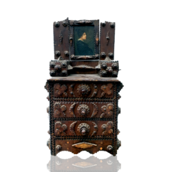 [unattributed] American tramp art : Tramp art miniature chest of drawers with oil painting portrait, ca.1890s.