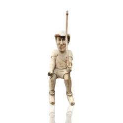 [unattributed] American folk art : Carved wood figure fishing, ca.1880s.